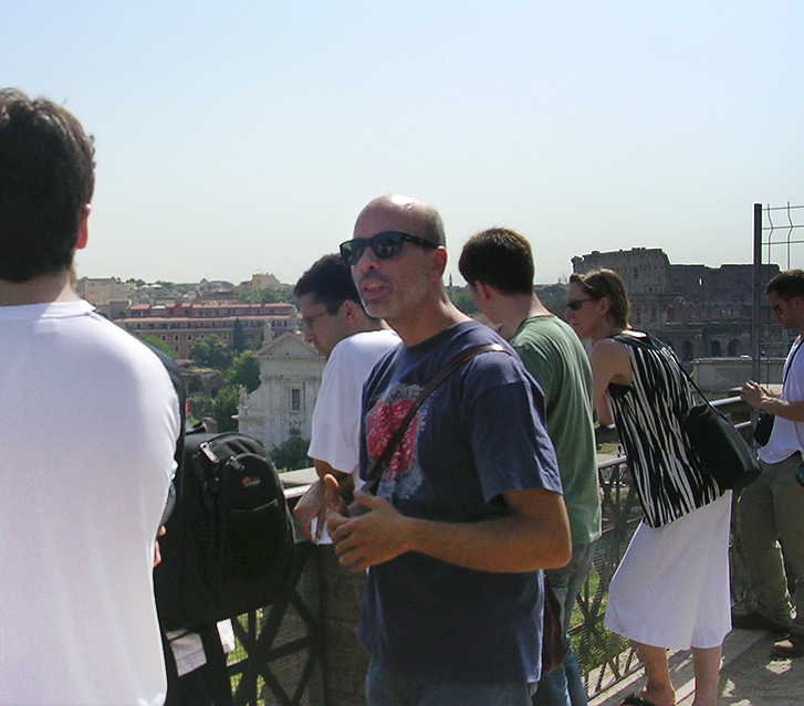 Mr. Castelli talking to a group of students during a tour of Rome
